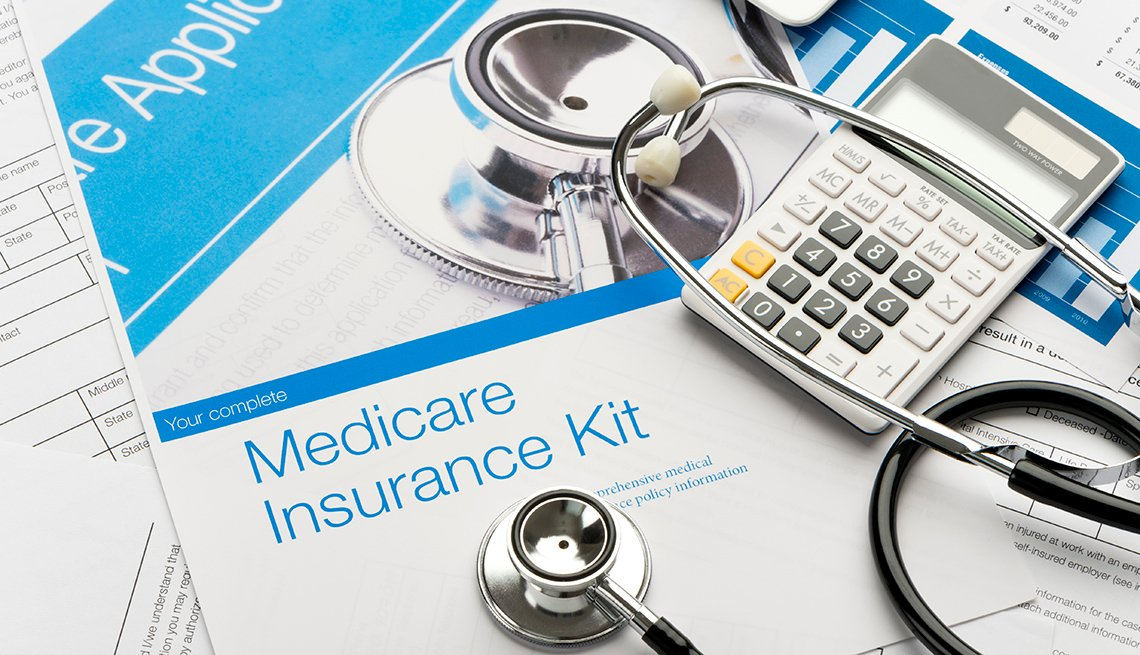 Medicare brochure with paperwork and a stethoscope..
