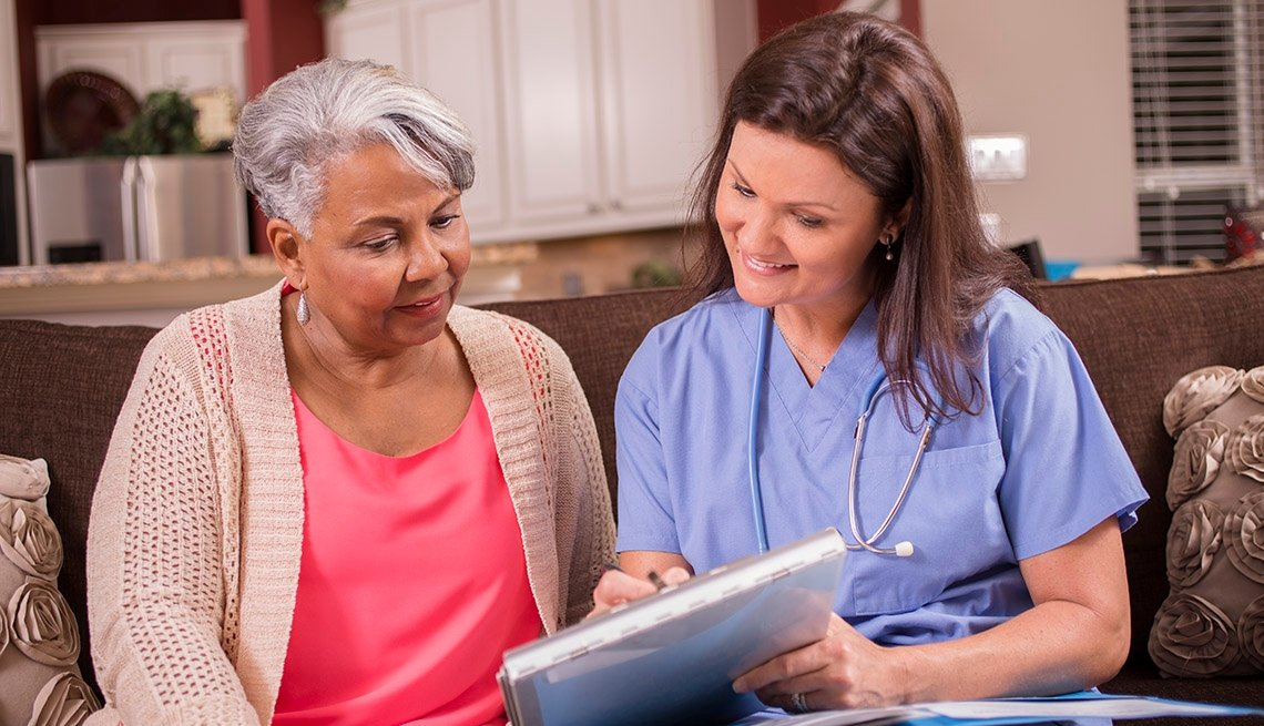 Doctor and patient reviewing test results in a assisted living facility