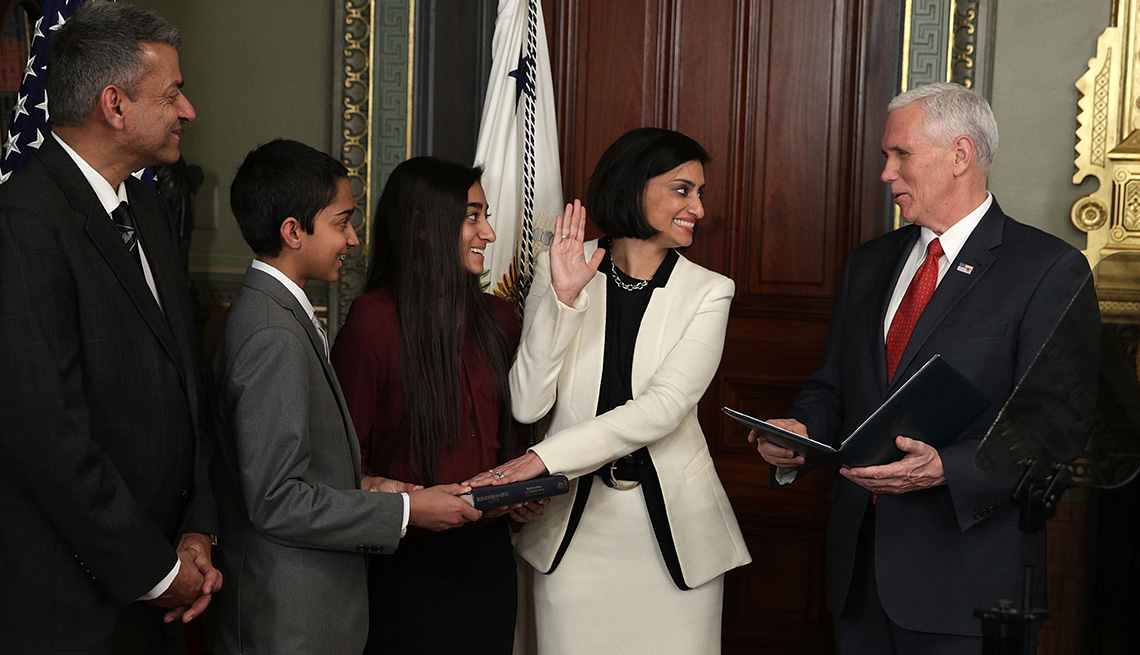 Seema Verma participates in a swearing-in ceremony, officiated by U.S. Vice President Mike Pence  as her family watches.