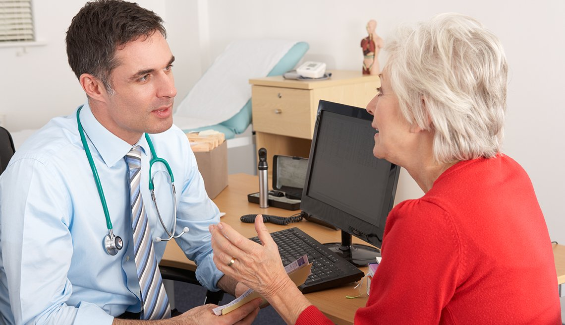 older female patient talks with doctor during a a Medicare wellness visit