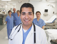 male doctor with nurses in background