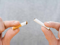hands breaking cigarette - Medicare recipients can now access smoking cessation benefits