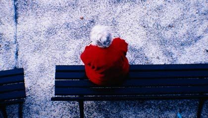 Older Woman Alone On A Park Bench