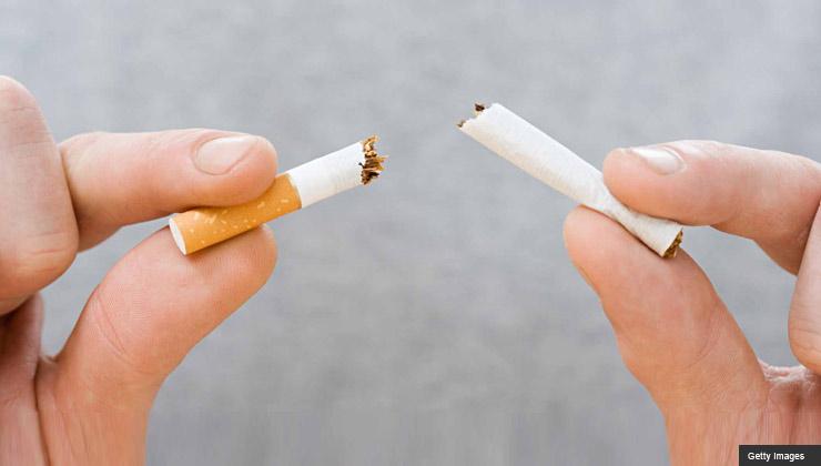 hands breaking cigarette - Medicare recipients can now access smoking cessation benefits