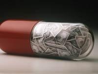 Una pastilla llena de billetes de dólar