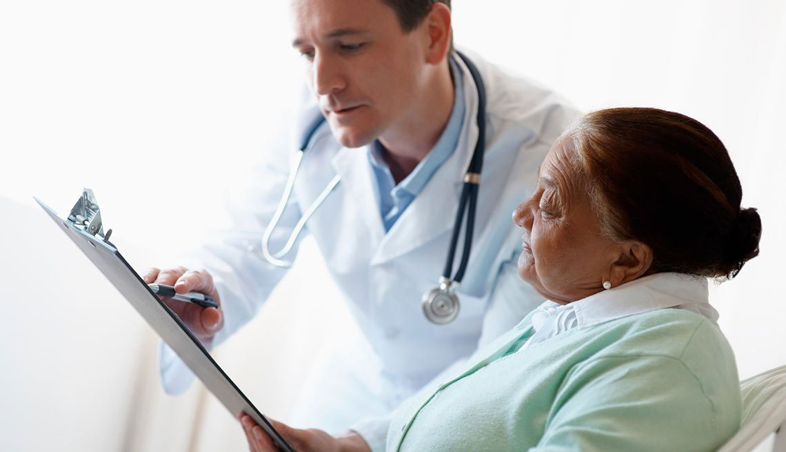 Doctor going through a report with a senior patient