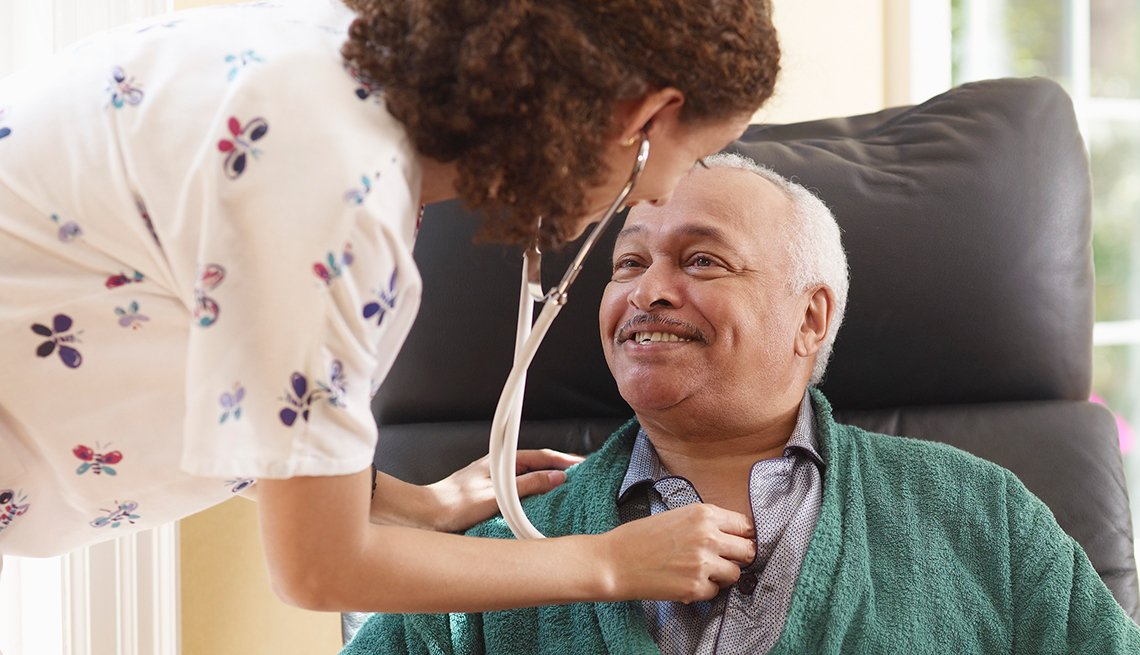 Mature man is cared for by nurse
