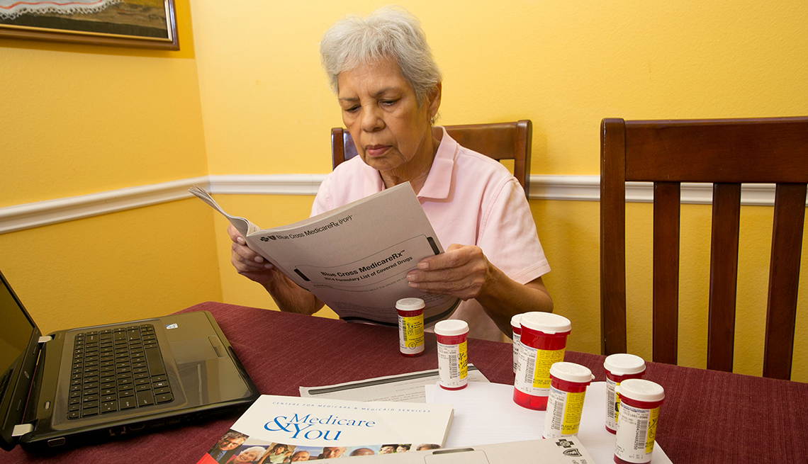 Woman reading Medicare booklet