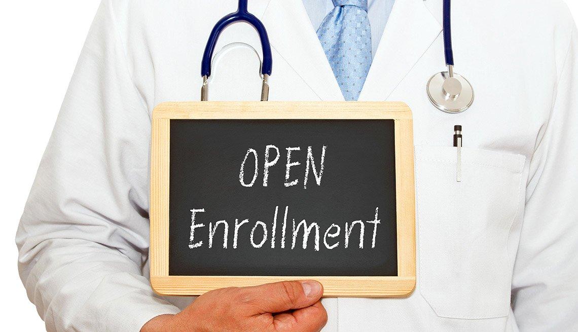 doctor holding open enrollment sign