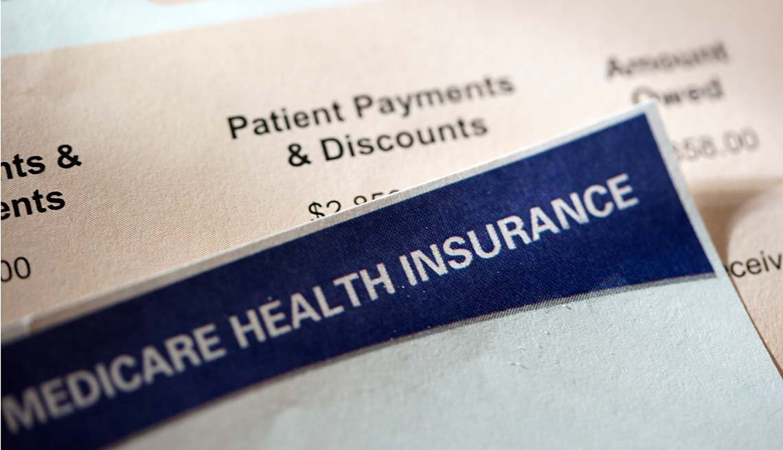 Close-up of Medicare card and a hospital bill.