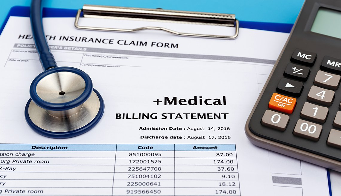 medical bill statement with a calculator and stethoscope