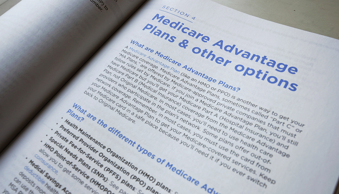 A 2019 U.S. Medicare Handbook is open showing a page on Medicare Advantage plans and other options