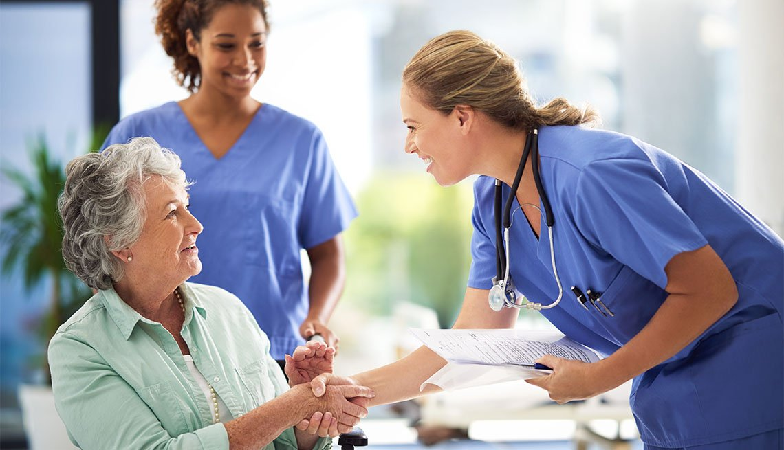 Older woman with medical providers