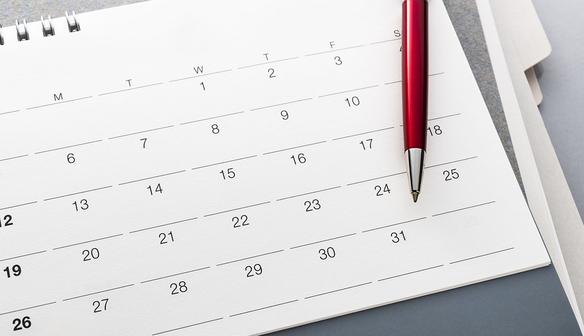monthly calendar with pen