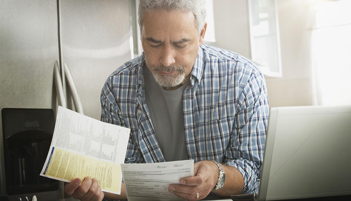 Man holding bills