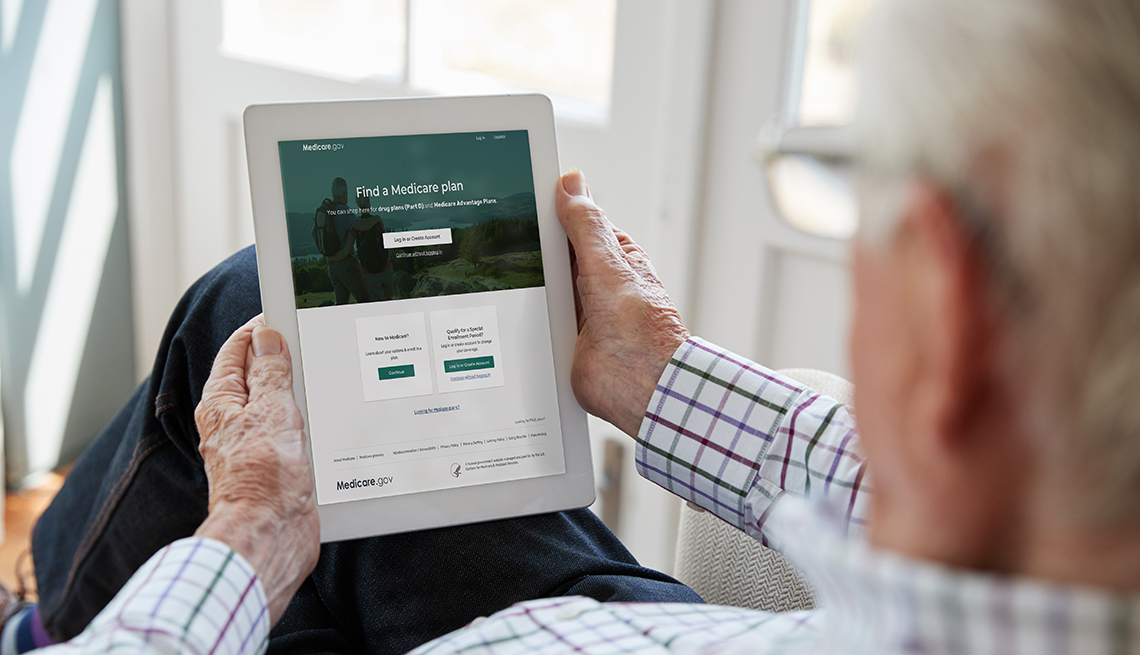 A man looking at a tablet showing the Medicare Plan Finder website