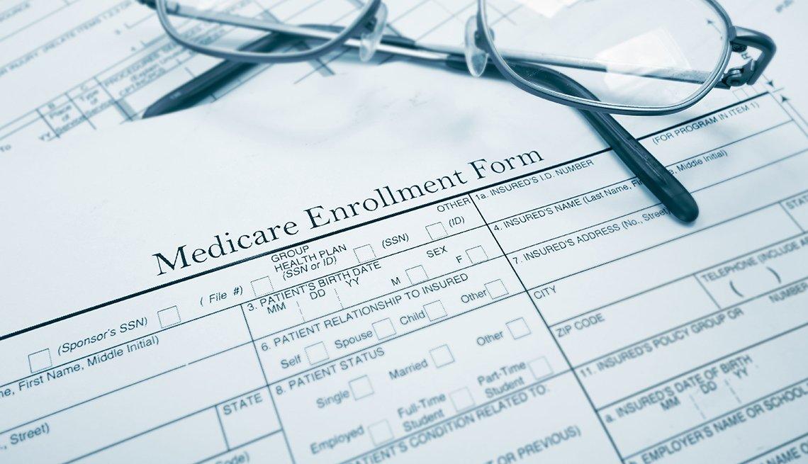 Medicare enrollment form and glasses