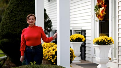Janet Ferracci-Carter poses for a portrait at her home in Southington, CT - Caregiving