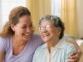 Mother and daughter hugging, tax breaks available to caregivers