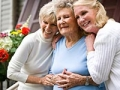 Senior mother with two daughters. Sibling relationships and caregiving.