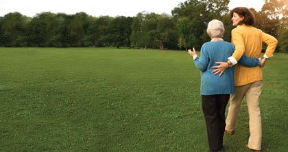 mother and daughter walking in park. caregiver resources and information on assisted living and more.