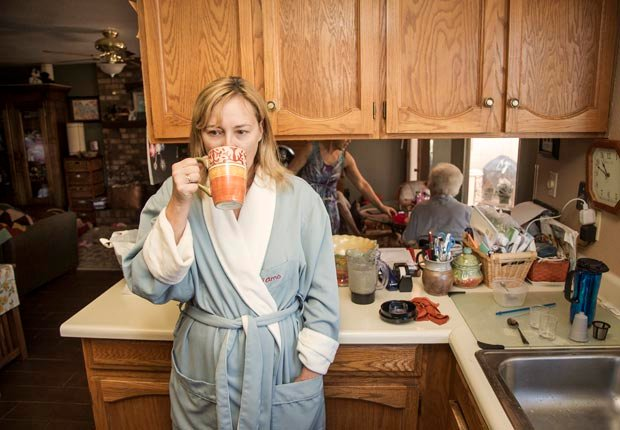 Amy Goyer at her home in the morning, waking up early to work and spend time with parents, Juggling Work and Caregiving (Beth Perkins Photography)