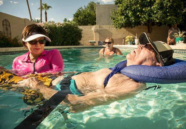 Amy Goyer, her father and physical therapist Donna in the pool, Juggling Work and Caregiving (Beth Perkins Photography)