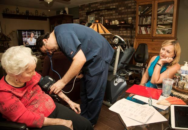 Amy Goyer at her home with her mother and her mother's new mobile doctor. Dr. Livi, Juggling Work and Caregiving (Beth Perkins Photography)