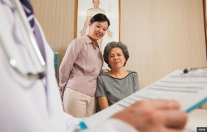 Senior mother and daughter at doctor's office. Tips for avoiding conflict during doctor visits. (Alamy)