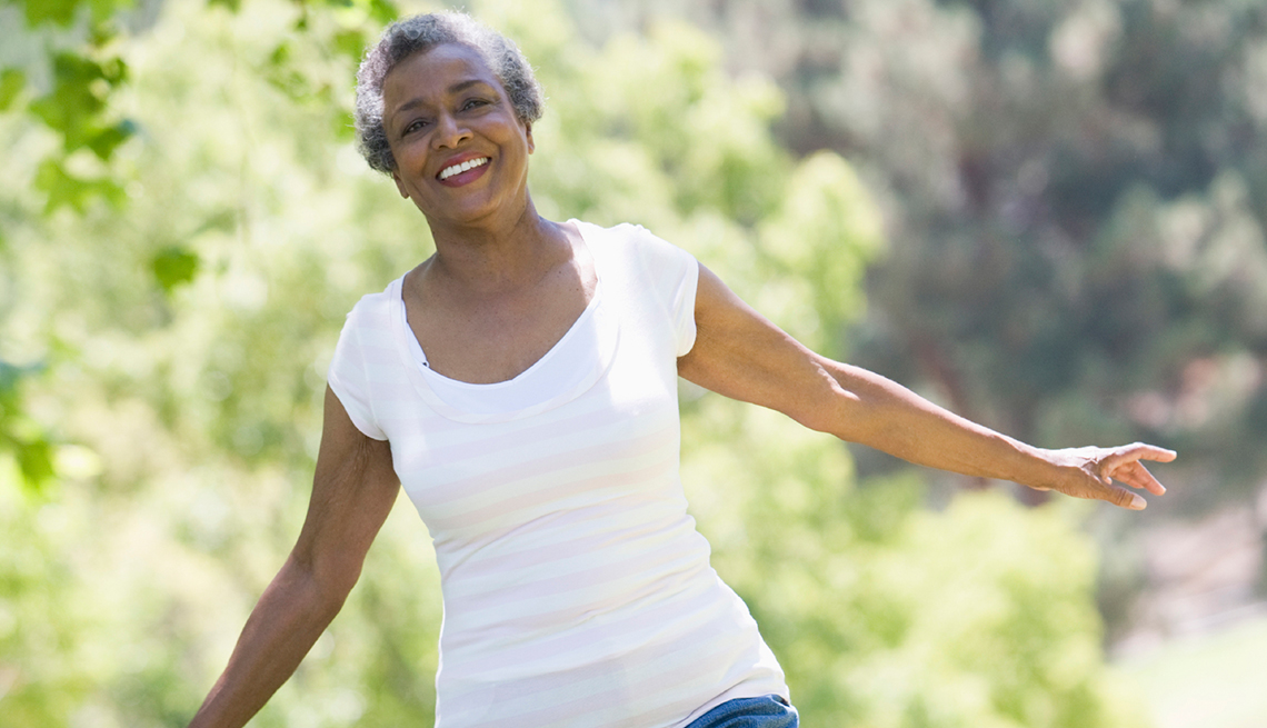 10 Ways for Caregivers to Nurture Themselves, Mature African American woman exercising in park