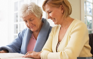 Senior mother and daughter reading together. Ask the Caregiving Resource Center Expert.