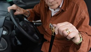 Very old gentleman at the wheel of a car