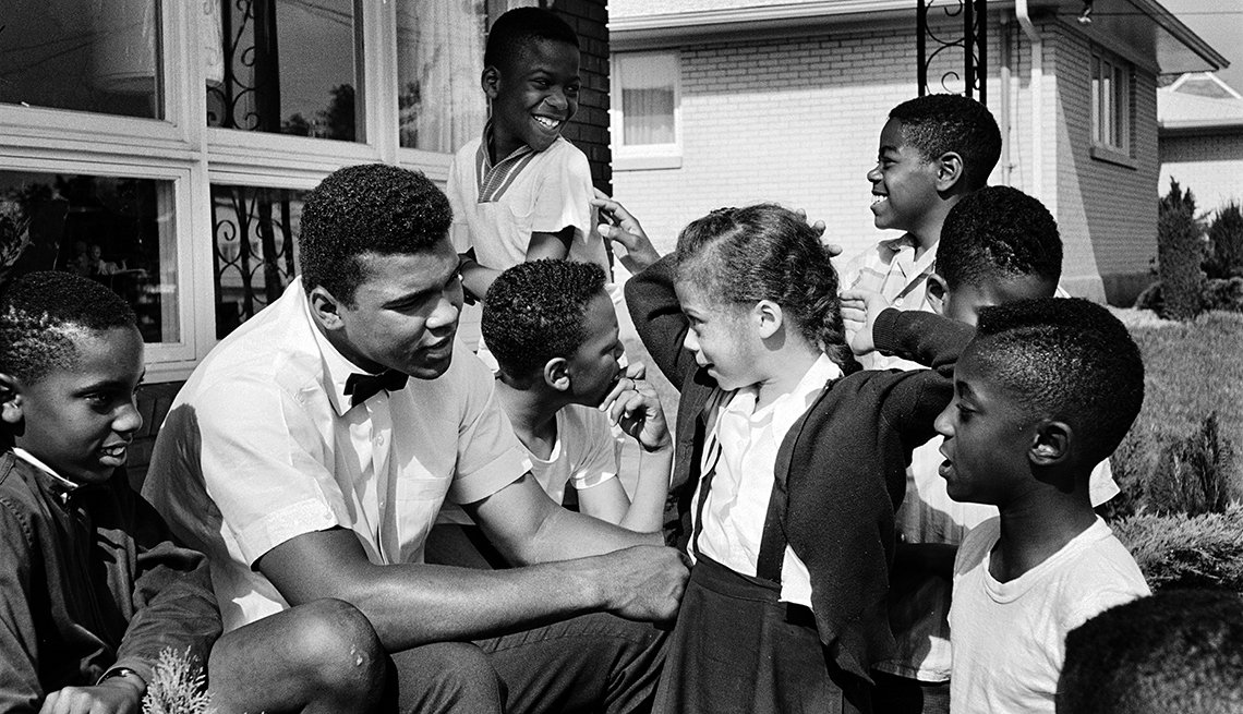 "Lonnie and Mohammed Ali, Muhammad Ali with neighborhood kids in Louisville, including Yolanda ""Lonnie"" Williams who would become his wife in 1986"