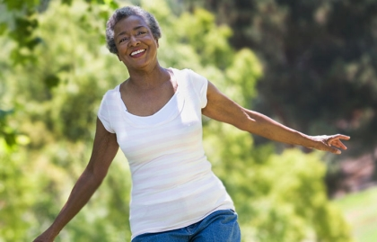 Senior woman exercising in park, 10 Ways for Caregivers to Nurture Themselves