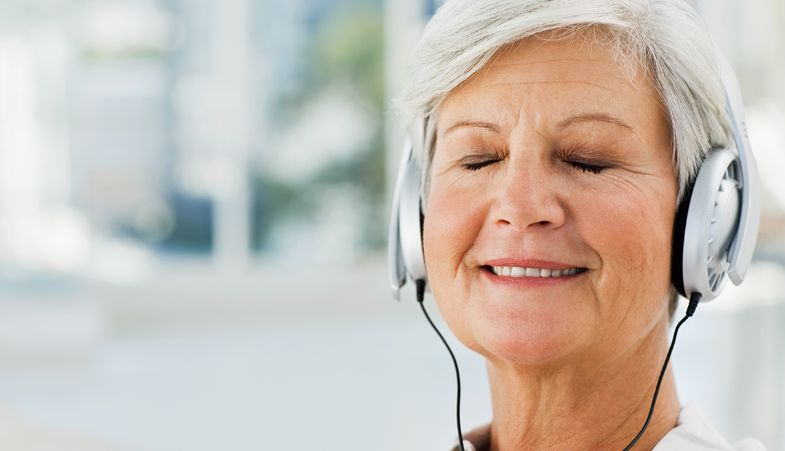 mature woman listing to music