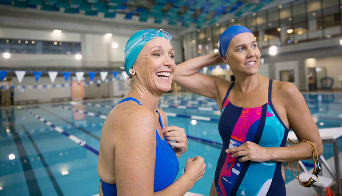CRC: How to Stay Motivated to Exercise, Two Women smiling in indoor pool