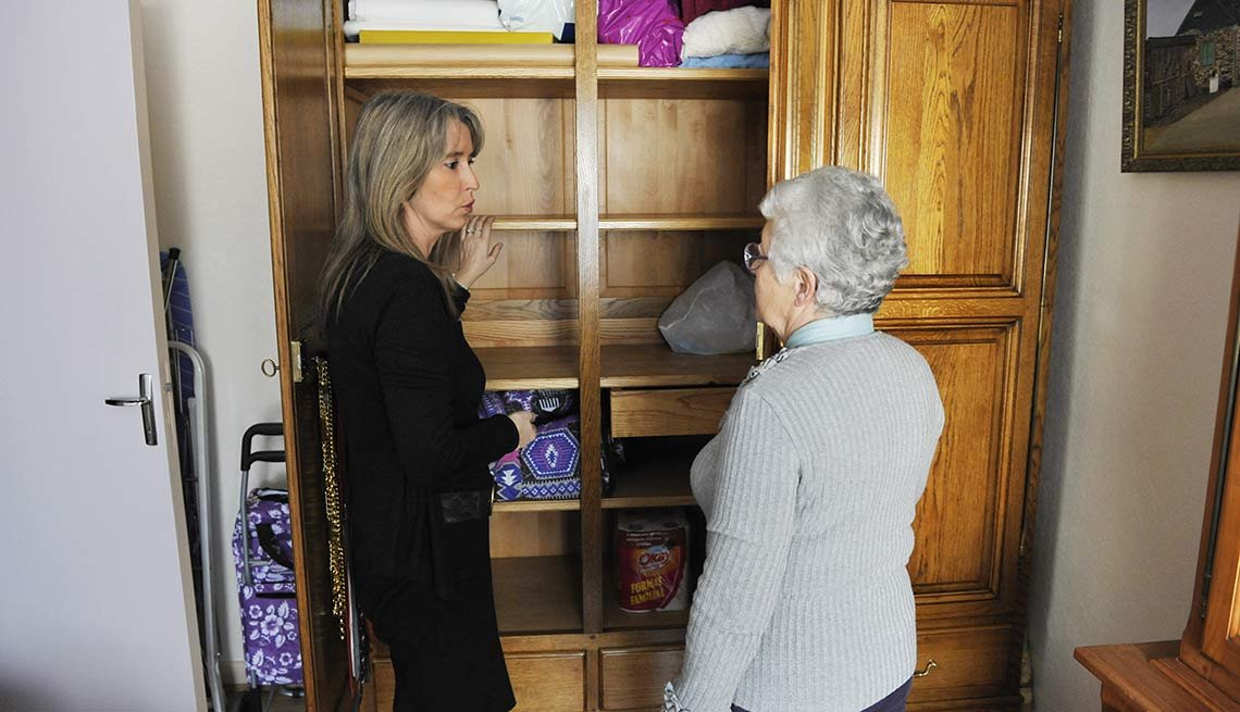 A geriatrics coordinator visited the home of a senior woman living alone, Caregiving Transitions