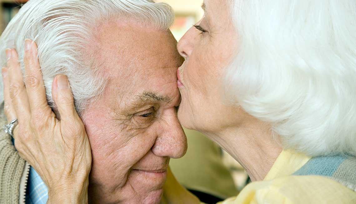 An elderly couple kissing, Understanding Long-Term Care Insurance