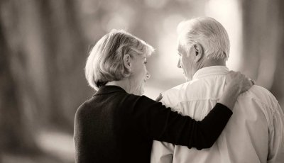 Mature woman's arm around a man's shoulders, Caregiving Resource Center