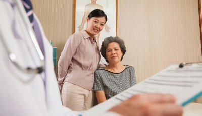 Senior mother and daughter at doctor's office, Tips for avoiding conflict during doctor visits