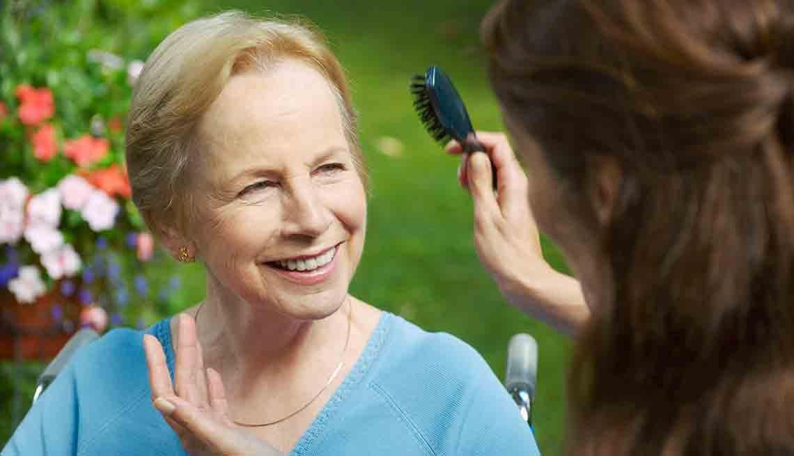 Woman brushing older woman's hair, Caregiving Resource Center