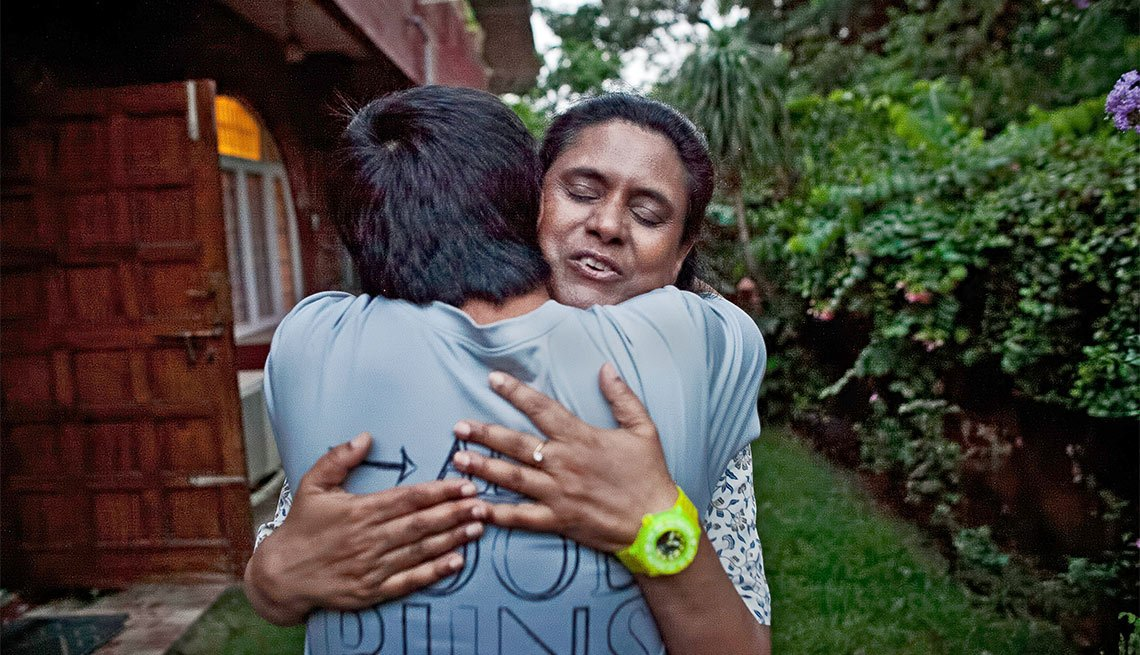 A Day in the Life of a Caregiver, Anita Raghavan hugs her son Tavrick Lawless