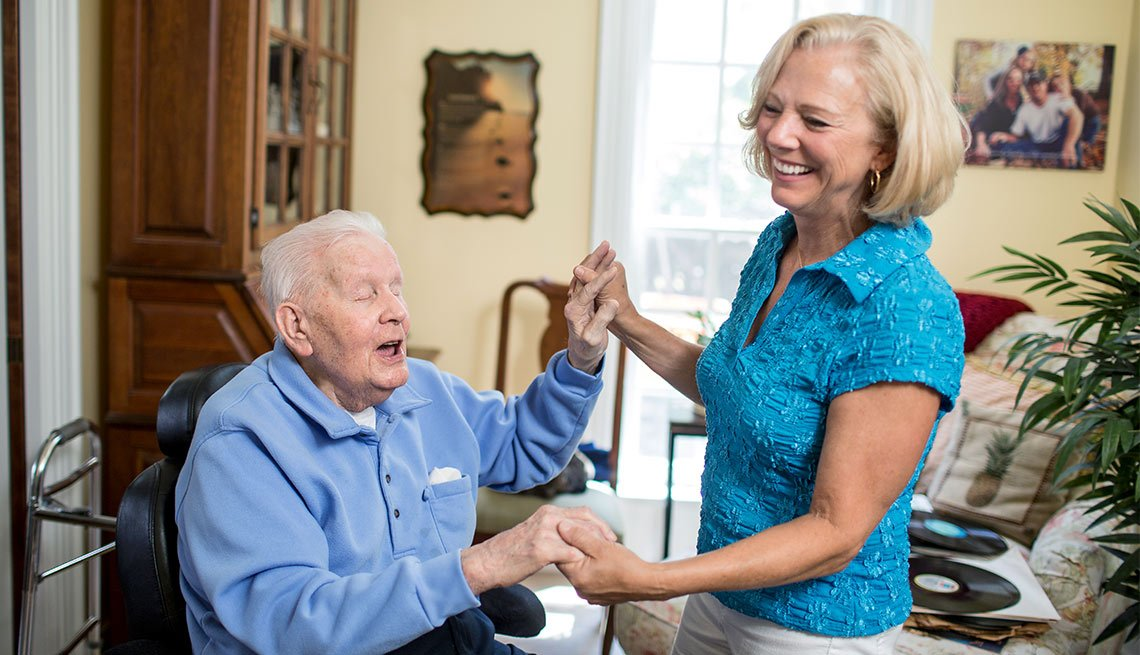 A Day in the Life of a Caregiver, Cyndie Rhodes dances with her father George Fix