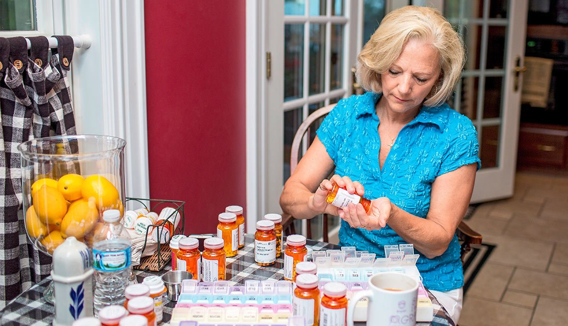 A Day in the Life of a Caregiver, Cyndie Rhodes goes through meds at the home of her parents