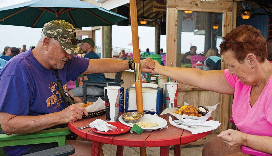 A Day in the Life of a Caregiver, DW Huggins and Alice Arnold pray over a meal