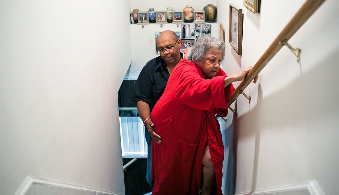 A Day in the Life of a Caregiver, Marcus Butler helps his mother Melida up the stairs