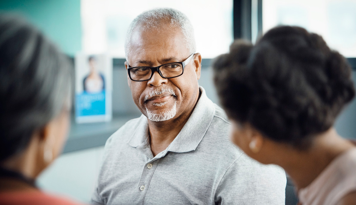 Man looking at people: Common Caregiving Conflicts