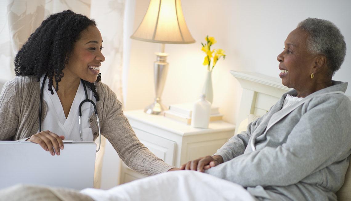 african senior patient with female nurse
