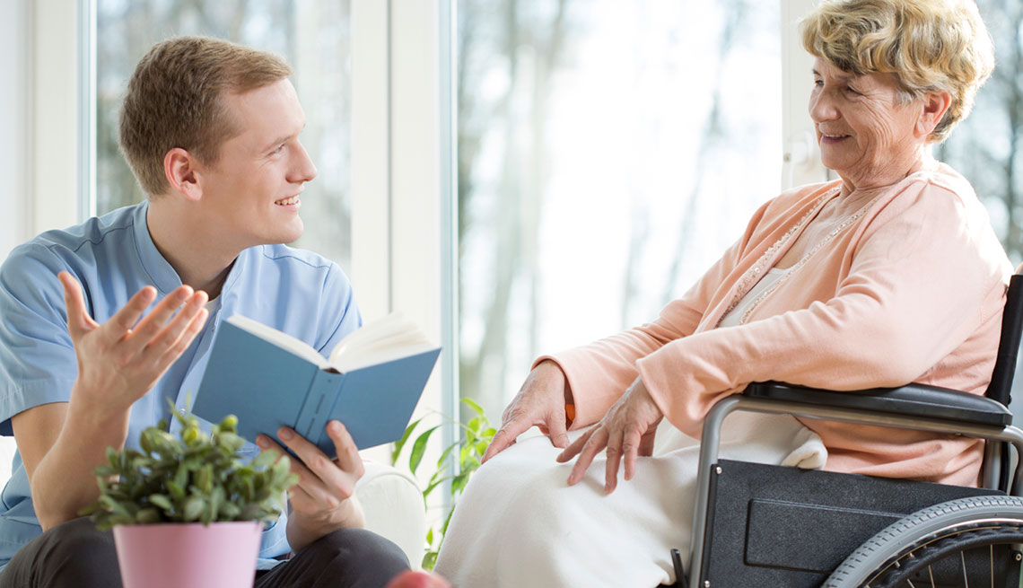 Care assistant reading book
