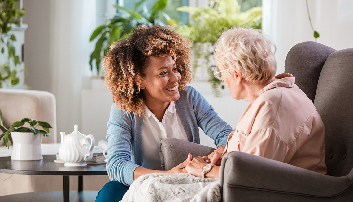 Female caregiver talking with patient at a senior living center